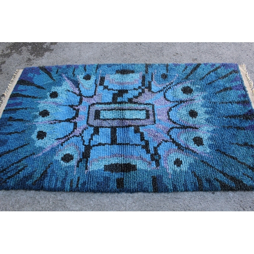 15 - Mid 20th Century long pile rug with an abstract design in shades of blue, purple and black, possibly...