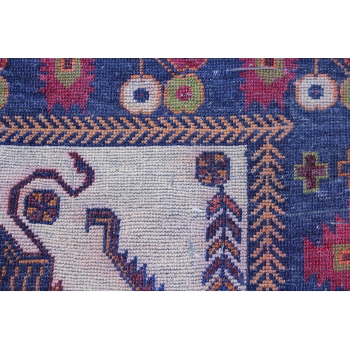 17 - Small modern Belouch rug with animal and bird design on an ivory ground with borders, 4ft 10ins x 2f...