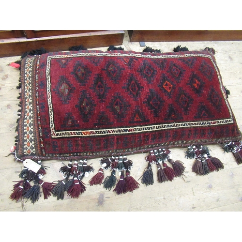 2 - Afghan carpet fragment covered floor cushion with bead and shell work tassels, 24ins x 44ins