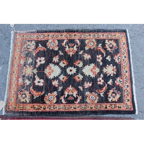 22 - Small Afghan Ziegler mat with a floral design on a dark ground, 2ft 10ins x 2ft 2ins approximately, ...