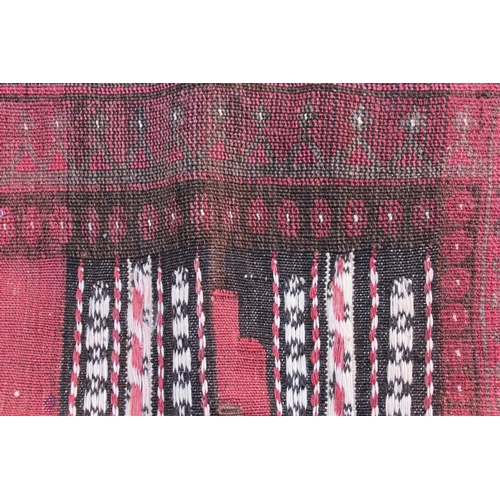 23 - Small square Afghan rug with a Kelim centre panel and piled border, 4ft x 4ft 4ins approximately