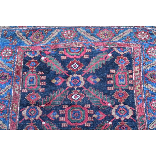 26 - Antique Kurdish rug, having all over stylised floral design, midnight ground with multiple borders, ...