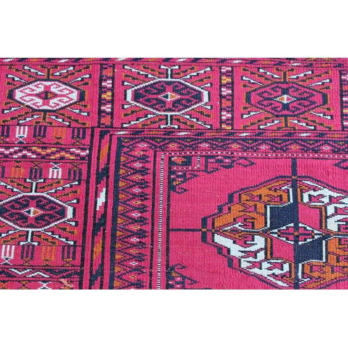 27 - Silk Tekke rug with three rows of ten gols on a wine red ground with borders, 75ins x 54ins approxim...