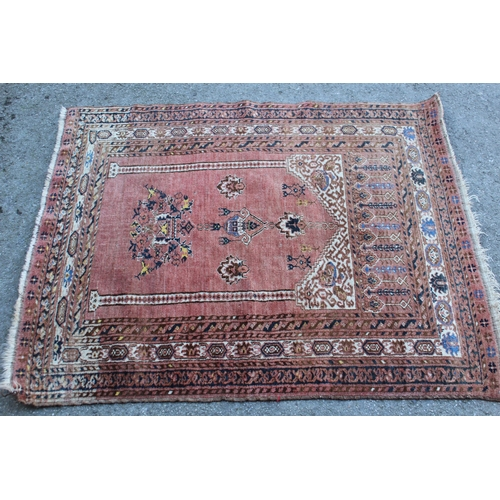 29 - Small Afghan prayer rug with a rose ground, 48ins x 41ins approximately