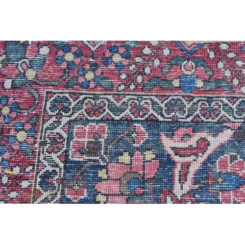 31 - Bakhtiari rug with centre medallion and all-over floral design with border (worn), approximately 90i...
