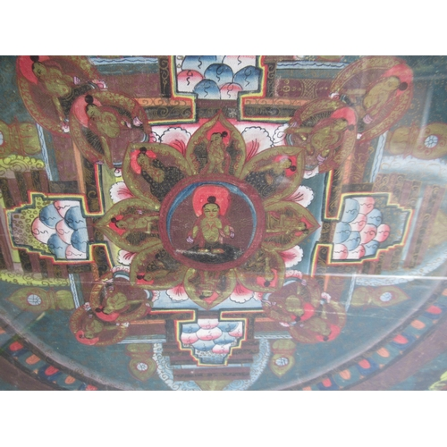 35 - Far Eastern Thangka painted with Buddhistic figures in a central circle and bordered by other figure...