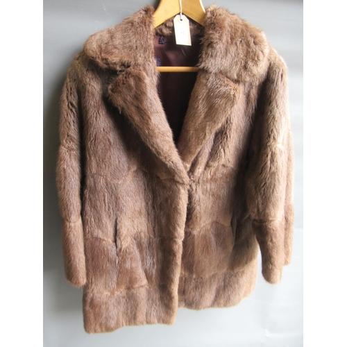 37 - Ladies dark brown three quarter length mink fur coat together with a similar mid tan jacket