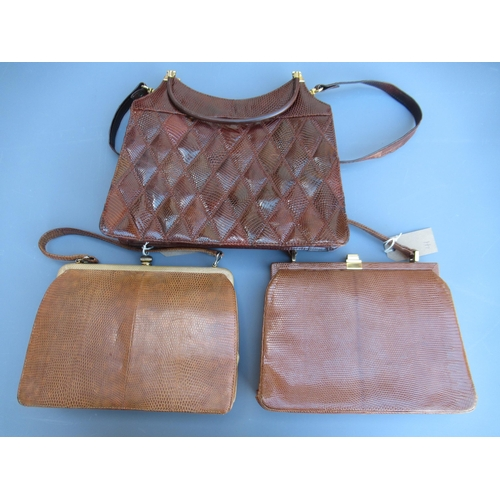 41 - Two Mappin & Webb simulated snake skin leather handbags and another similar handbag