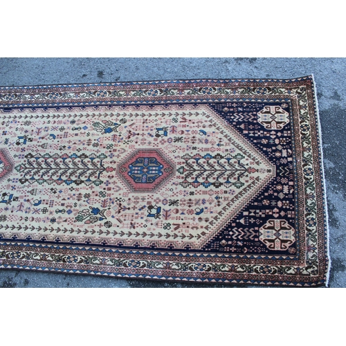 6 - Abadeh runner with a medallion and all-over design on a blue ground with borders, 3.1m x 95cms appro...