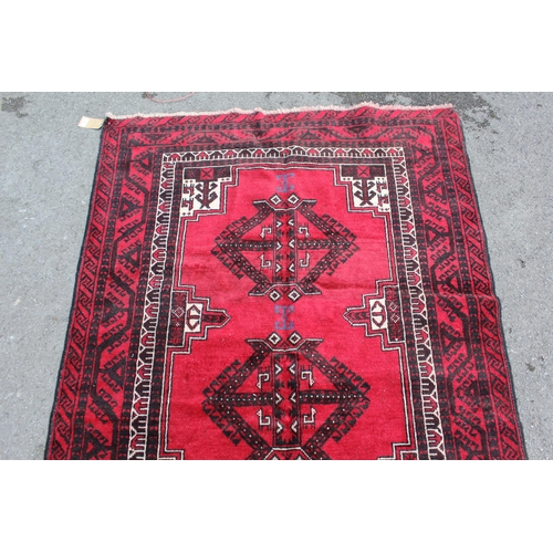 9 - Turkoman rug with typical all-over design, 2.55m x 1.24m