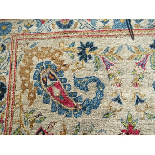 25 - Indo Persian rug of all-over floral and bird design with multiple borders on a beige ground, approxi...