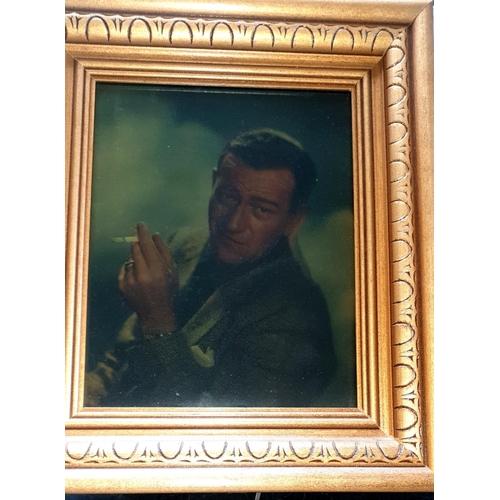 52 - John Wayne Lightbox. Very unusual boxed lenticular picture frame of John Wayne. The back needs to be...