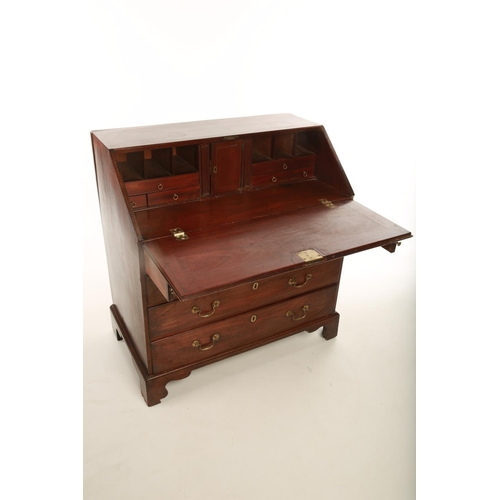 1 - A Georgian mahogany fall front writing bureau; the drop-down flap opening reveal interior above four...