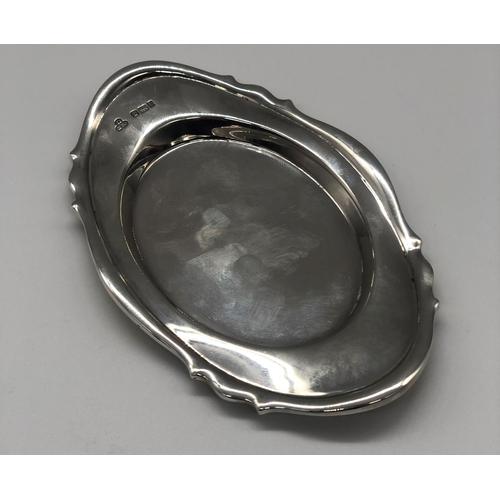 11 - An Edwardian hallmarked silver oval trinket tray; Sharman D. Neill Ltd, Sheffield 1903 with shaped r...