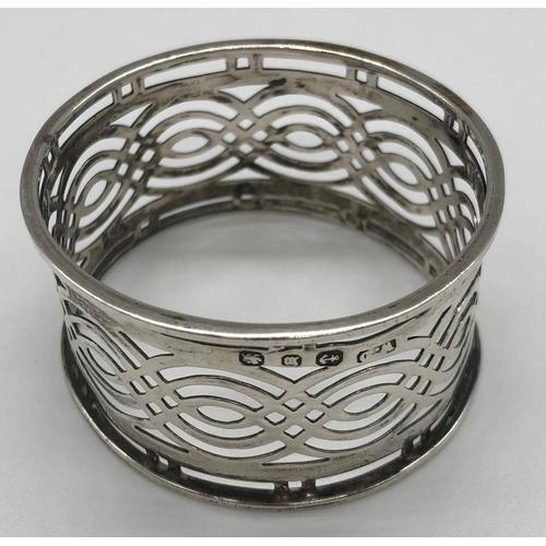 12 - A late Victorian hallmarked pierced silver napkin ring; William Davenport, Birmingham 1886; 4.2cm di...