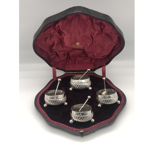 13 - A set of four late Victorian hallmarked silver salts and spoons; Hukin & Heath London 1892; the salt...