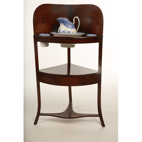 22 - A George III mahogany corner washstand with single drawer on four splayed supports complete with a f...