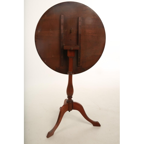 26 - A late Victorian / early 20th century mahogany circular tripod table; inset with central marquetry p...