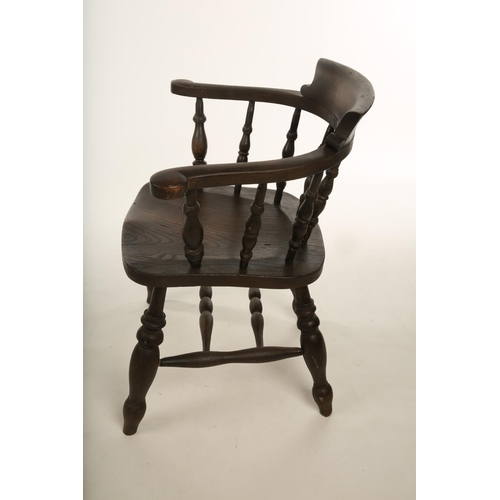 28 - A mid 20th century painted pine Captain's style open arm chair; raised on turned supports with doubl...