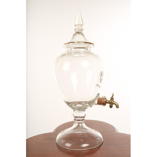 34 - An Edwardian Red Seal Whisky counter top clear glass dispenser and tap; raised on circular domed foo...