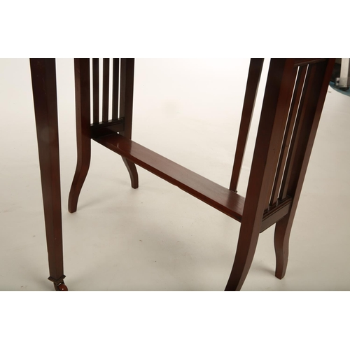 35 - An Edwardian mahogany Sutherland occasional table raised on outswept supports terminating in castors...