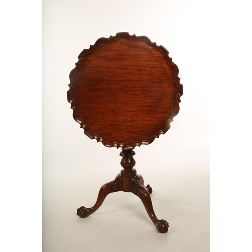 38 - A mid Victorian mahogany pie crust topped occasional table with birdcage movement; the tilt top rais...