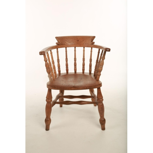 4 - An early 20th century beech Captains style chair; with turned spindle back; raised on turned support...