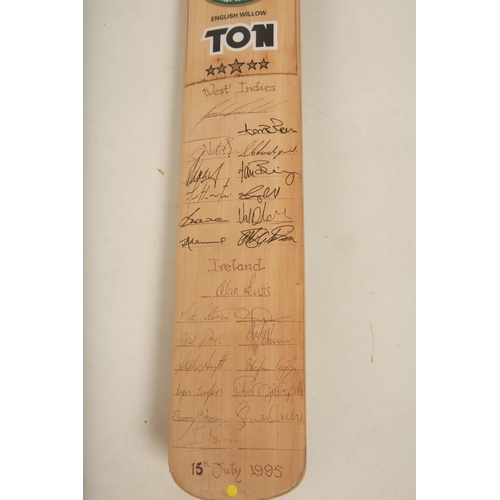 41 - A late 20th century signed Cricket bat signed by the West Indies and Irish Cricket teams; dated 15th...