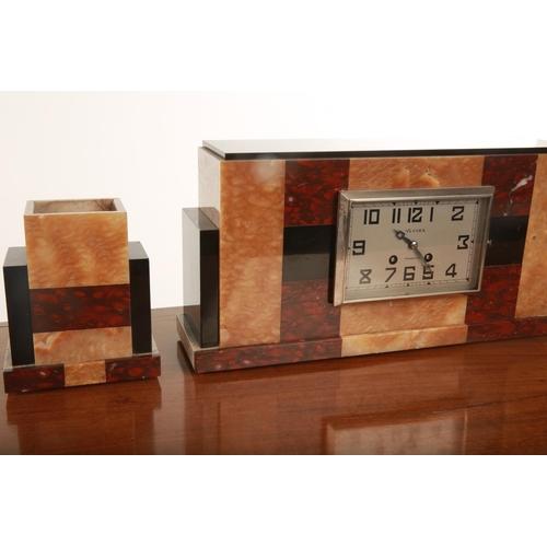 46 - An Art Deco three piece Vivier clock garniture; the silvered dial with black painted Arabic numerals...