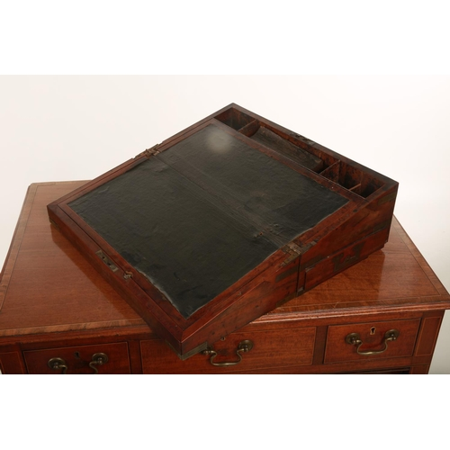 58 - A mid Victorian campaign style walnut Gentlemen's writing slope; with applied brass mounts; opening ...