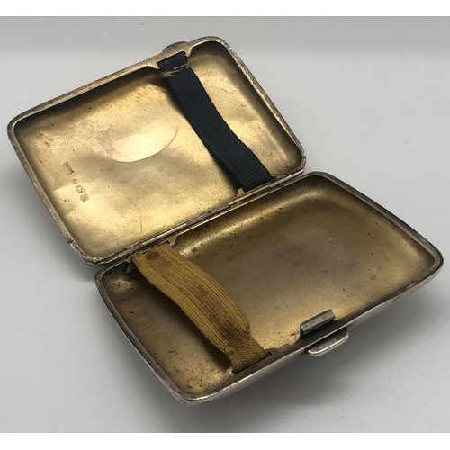 60 - A George V hallmarked silver cigarette case; Walker & Hall; Birmingham 1918; the hinged cover monogr...