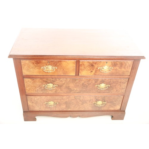 36 - An Edwardian walnut veneered chest of two short over two long drawers with brass swing handles raise...