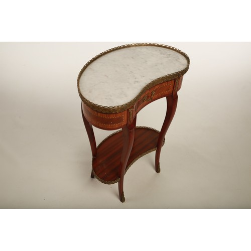 51 - A 19th century French Kingwood kidney shaped table; with shelf below raised on outswept supports