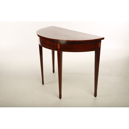 52 - An Edwardian inlaid satinwood and mahogany demi - lune side table; raised on square tapering support...
