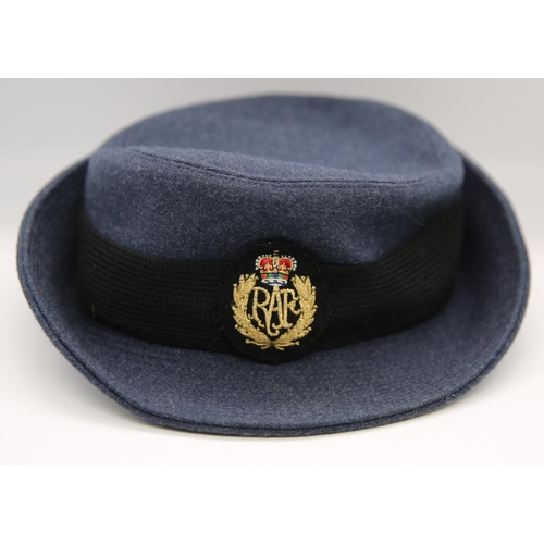 57 - Six military hats to include Royal Ulster Constabulary peak cap; three woman's Royal Air Force wooll...