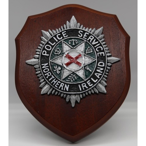 6 - A Northern Ireland Police Service easel plaque; 17cm long