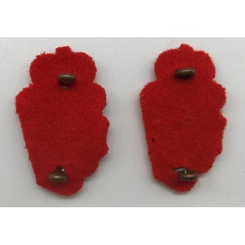 18 - A pair of Royal Ulster Constabulary (RUC) King's Crown Collar Badges; with red felt backing; 36mm lo...