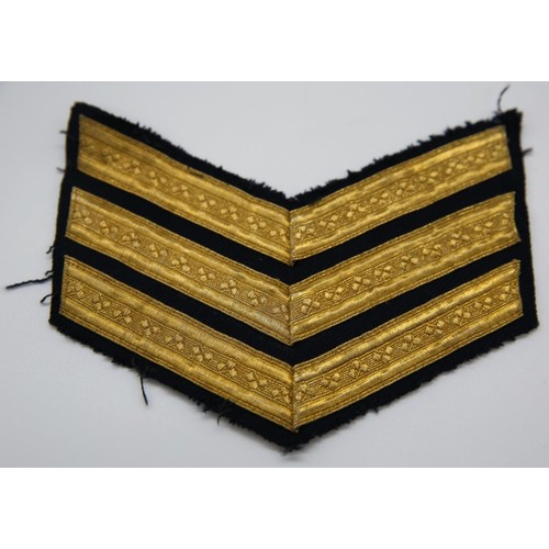 22 - A set  of Royal Ulster Constabulary Sergent stripes embroidered with shamrocks details; numbers to r...