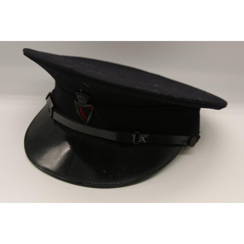 34 - A 1953 - 1970 Royal Ulster Constabulary Constables cap;  and chin strap with applied King's Crown ba...