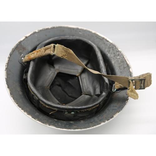 35 - A mid 20th century painted tin Policeman's helmet; 31cm diameter