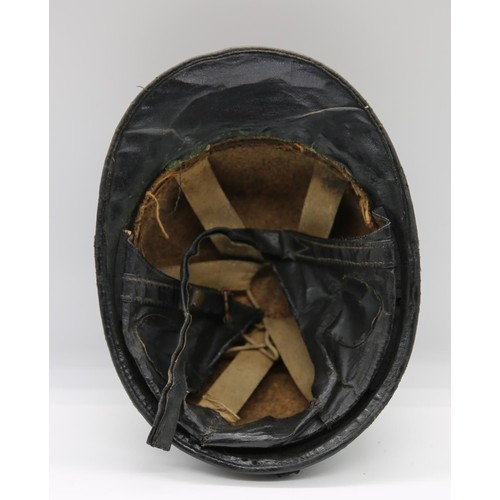 40 - A late 1960s shalac coated cork lined peak crash helmet; with chin strap; applied King's Crown; 28.5...
