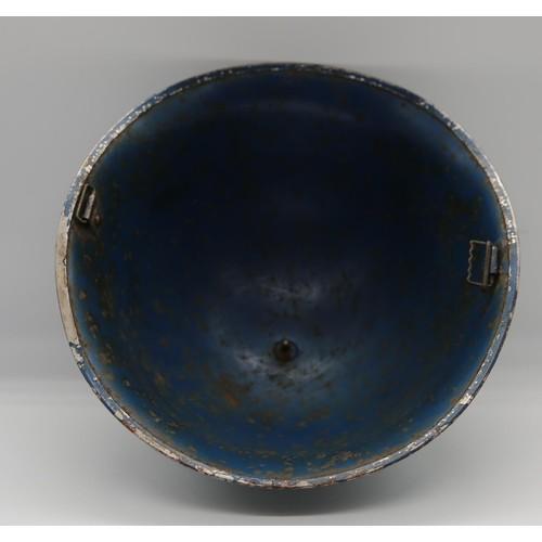 41 - A 1930s / 1940s blue painted tin Police helment; 31.5cm