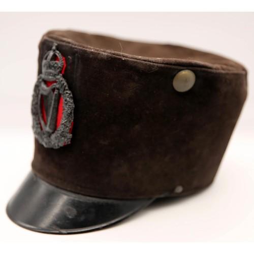 45 - An early 20th century black velvet peak cap; applied Royal Irish Constabulary King's Crown plaque; c...