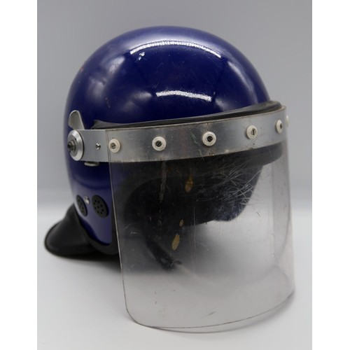 47 - A late 20th century Garda Siochana Riot Squad helmet; complete with visor and chin strap; 41cm long