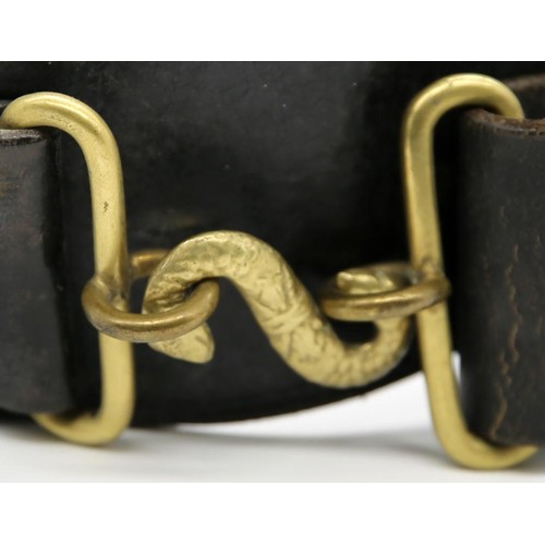 50 - A Royal Irish Constabulary brass and leather Snake Belt; overall length 100cm