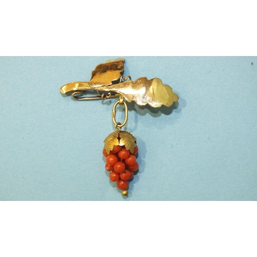321 - A small gold brooch in the form of leaves, with gilt metal-mounted coral grape bunch below, a pair o...