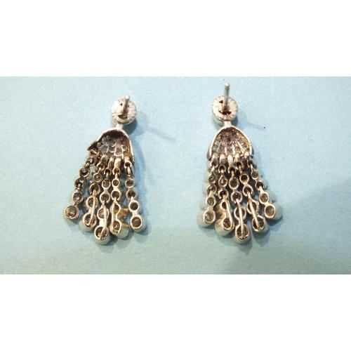322 - A pair of diamond tassel earrings, each with a millegrain-set old-cut diamond above a rose-cut diamo...