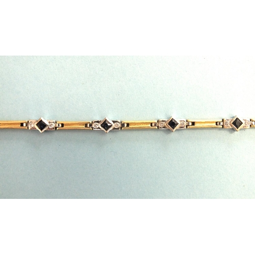 323 - An 18ct gold bracelet of eight white gold links, each set a square-cut sapphire between two brillian...