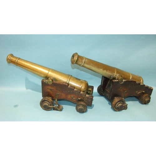 870 - An unusual pair of bronze signalling canons, each 55cm barrel with Victorian cipher, supported by a ...