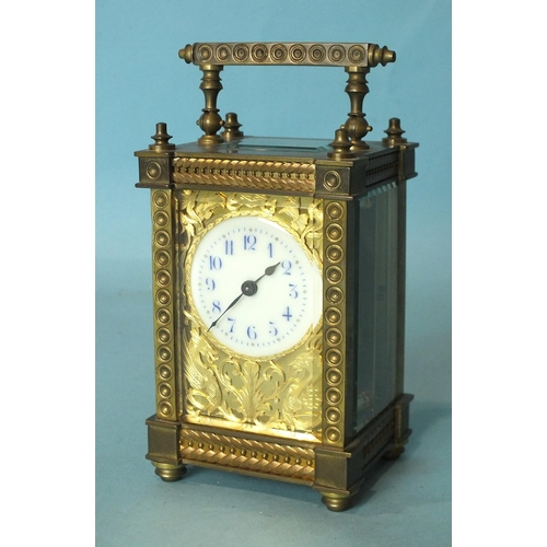 137 - A late-19th/early-20th century brass carriage timepiece with ornate gorge case, the face with cut br...